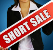 short sale sign held by lady